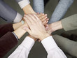 business team putting hands together to show unity