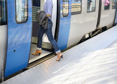 Fotografie, Obraz  Woman enters train