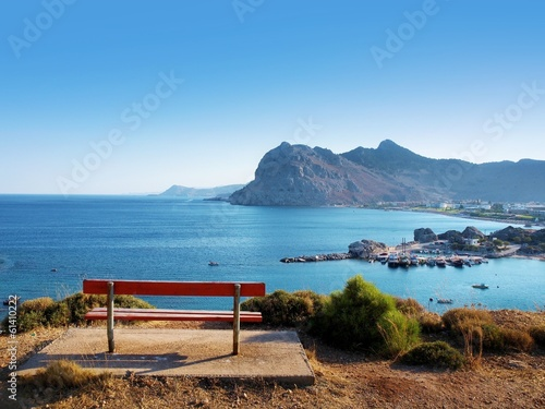 obraz lub plakat bench on a hill with sea ​​view