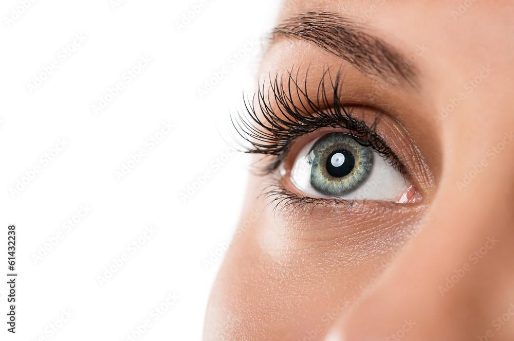 Fototapeta Close up of natural female eye isolated on white background