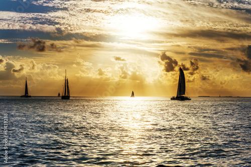 Sailboat and disherman at sunset Canvas Print