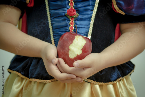 Fotografie, Obraz  Fantasy vintage of the beautiful Snow White with an apple