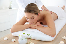 Woman In Spa Institute Receiving Oil Massage
