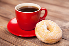 Tasty Donut With A Cup Of Coffee