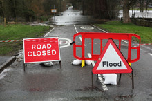 Road Closed And Flood Sign