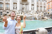Travel Couple Trowing Coin At ...