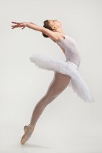 Young Ballerina Dancer In Tutu Performing On Pointes