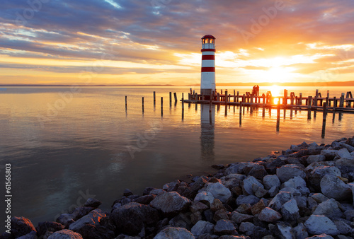 Foto Ocean sunset with lighthouse
