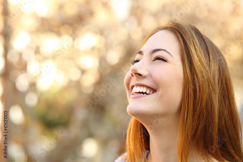 Fotografia  Portrait of a woman laughing with a perfect teeth