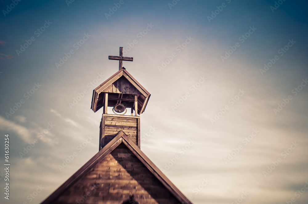 Fototapeta Rural old church steeple cross and bell tower