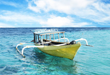Yellow Boat And Blue Water Ocean