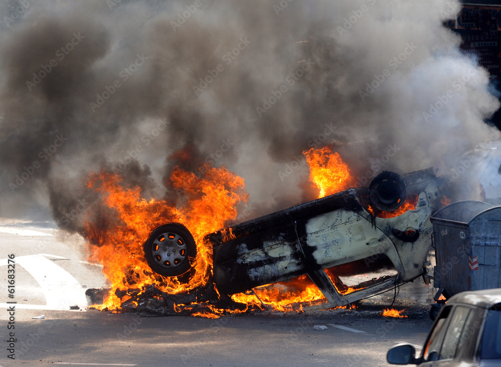 Fototapeta Burned car at street riots