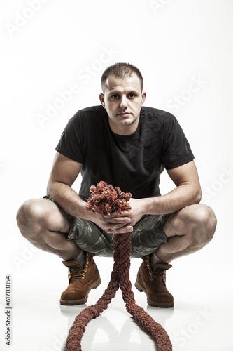 Fotografie, Obraz  man doing rope training isolated on white - boot camp