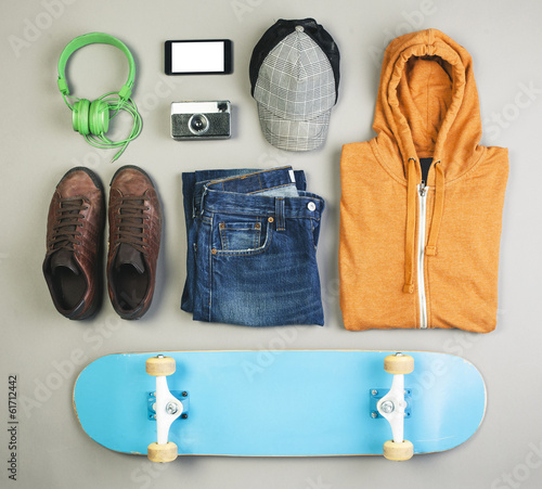 Outfit of skater man on grey background.