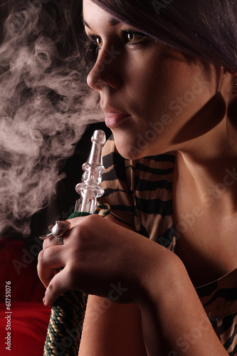 Fotografie, Obraz  Glamor portrait with a hookah pipe and smoke