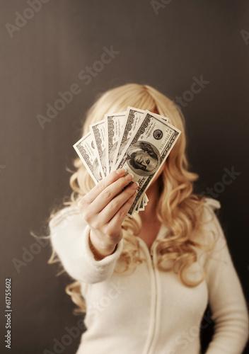 Fotografering  Girl holding 500 dollars