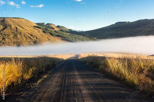 Fototapeta Dirt Road Blue Mist Mountains obraz na płótnie