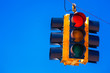 canvas print picture - A red traffic light with a sky blue background