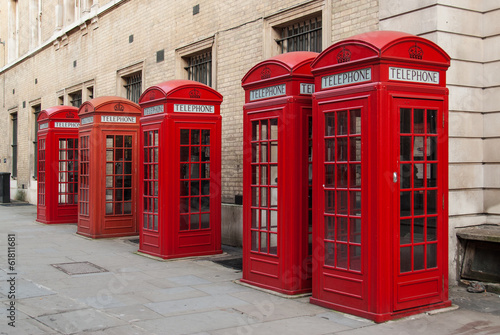 Foto op Canvas Londen Traditional red telephone boxes in London, UK