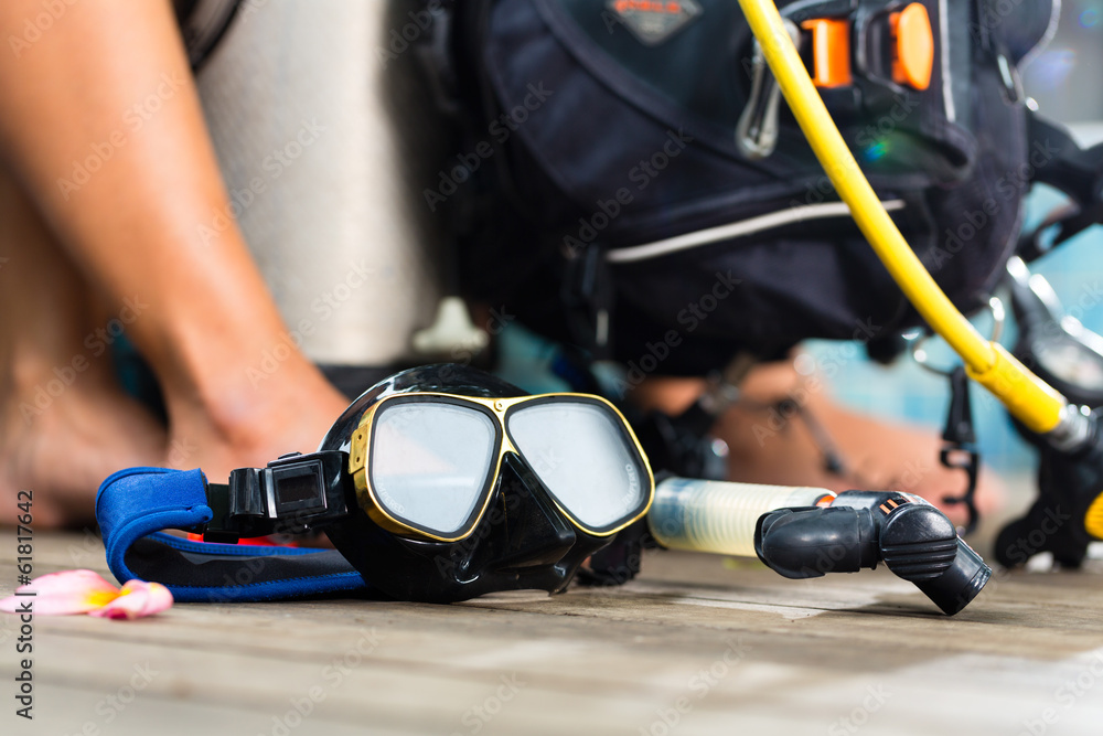 Fototapeta divemaster and students at the diver Course on holiday wearing a