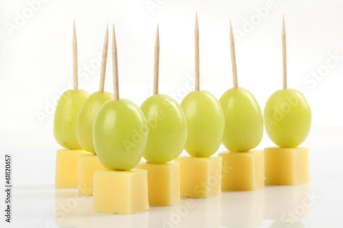 Recess Fitting Appetizer Appetizer - Grape with cheese on white background