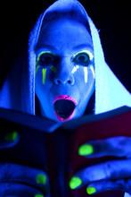 Woman Black Light Book Mouth Open