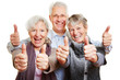 canvas print picture - Drei Senioren halten glücklich Daumen hoch