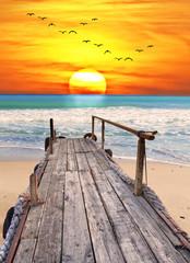 Fototapeta Optyczne powiększenie amanece en la playa tropical