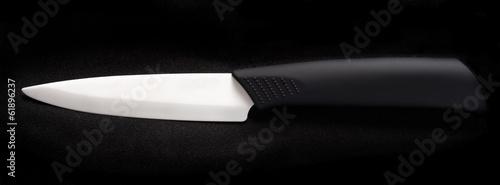 Fotografia, Obraz  White ceramic knife on a black background.