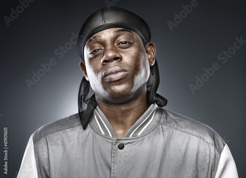 Fotografie, Obraz  african rapper on grey background with bold lighting