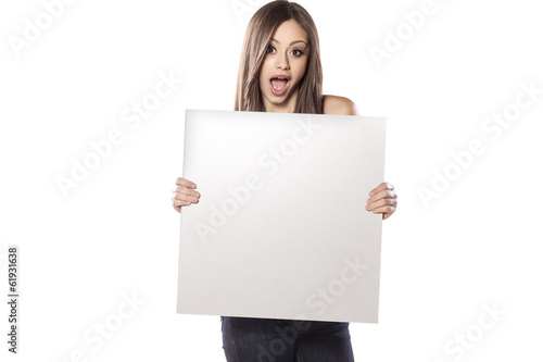 young pretty girl hold a empty board and shouting