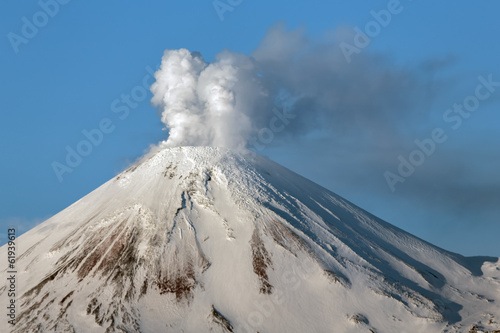 Poster Volcano Beautiful volcanic landscape: view of snowy cone of Avachinsky Volcano - active volcano of Kamchatka Peninsula on sunny day. Koryaksky-Avachinsky Group of Volcanoes, Russian Far East, Eurasia