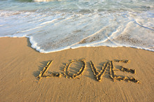 Word Love Drawn On Beach