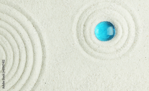 Blue bead in the sand