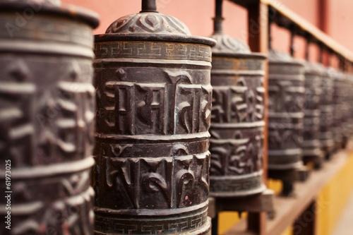 prayer mills in buddhist monastery