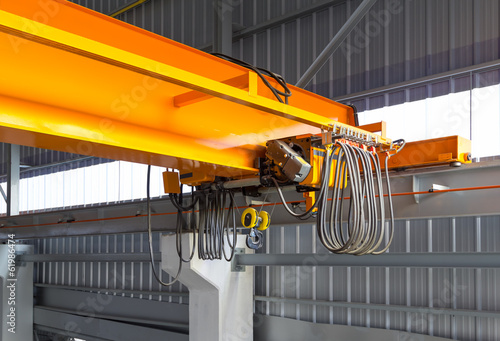 Overhead crane or bridge crane consists of parallel runways with a bridge between column also include hoist lifting and rope Fototapeta