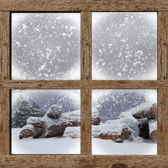 Fototapeta Winter outdoors view with firewood pile from wooden window