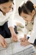 parents and child bundling newspaper