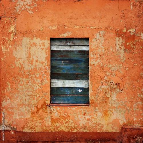 orange wall with a board up window - fototapety na wymiar