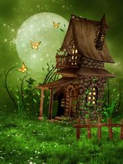 Fototapeta Fantasy Mała chatka elfów na wiosennej łące ze stokrotkami