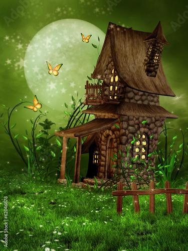 Fototapety, obrazy: Mała chatka elfów na wiosennej łące ze stokrotkami
