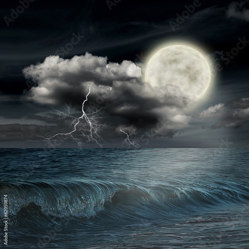 Foto op Plexiglas Indonesië storm evening on ocean and the moon
