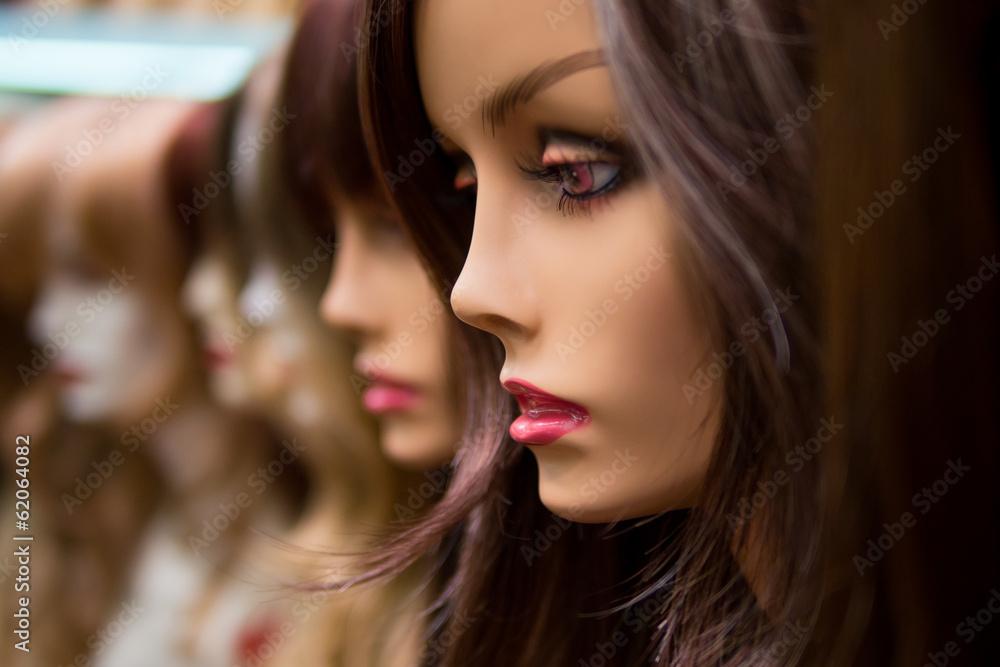 Fototapeta mannequins in a wig shop