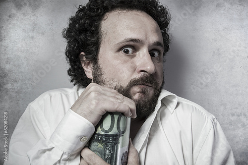Save, stingy businessman, saving money, man in white shirt with Canvas Print