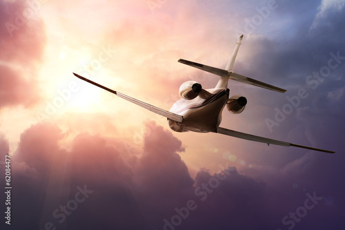 Photo Private Jet PLane in the sky at sunset