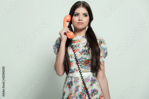 Poster  Retro 70s fashion. Pretty brunette girl with long hair. Calling