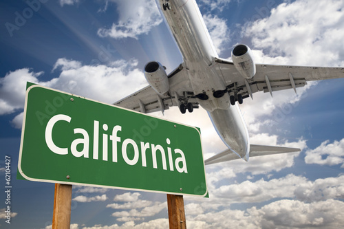 Photo  California Green Road Sign and Airplane Above