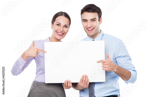 Fotografering  Business couple holding a placard