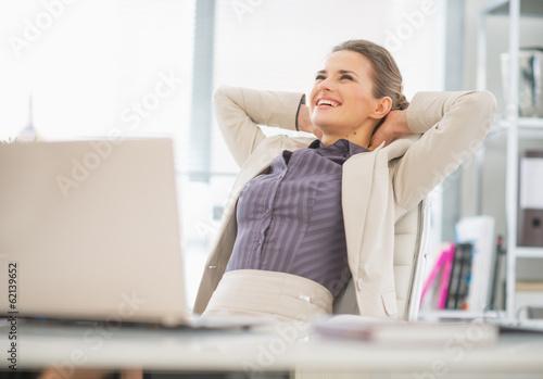 Fototapeta Portrait of relaxed business woman in office
