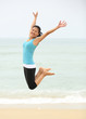 cheering woman jump at beach